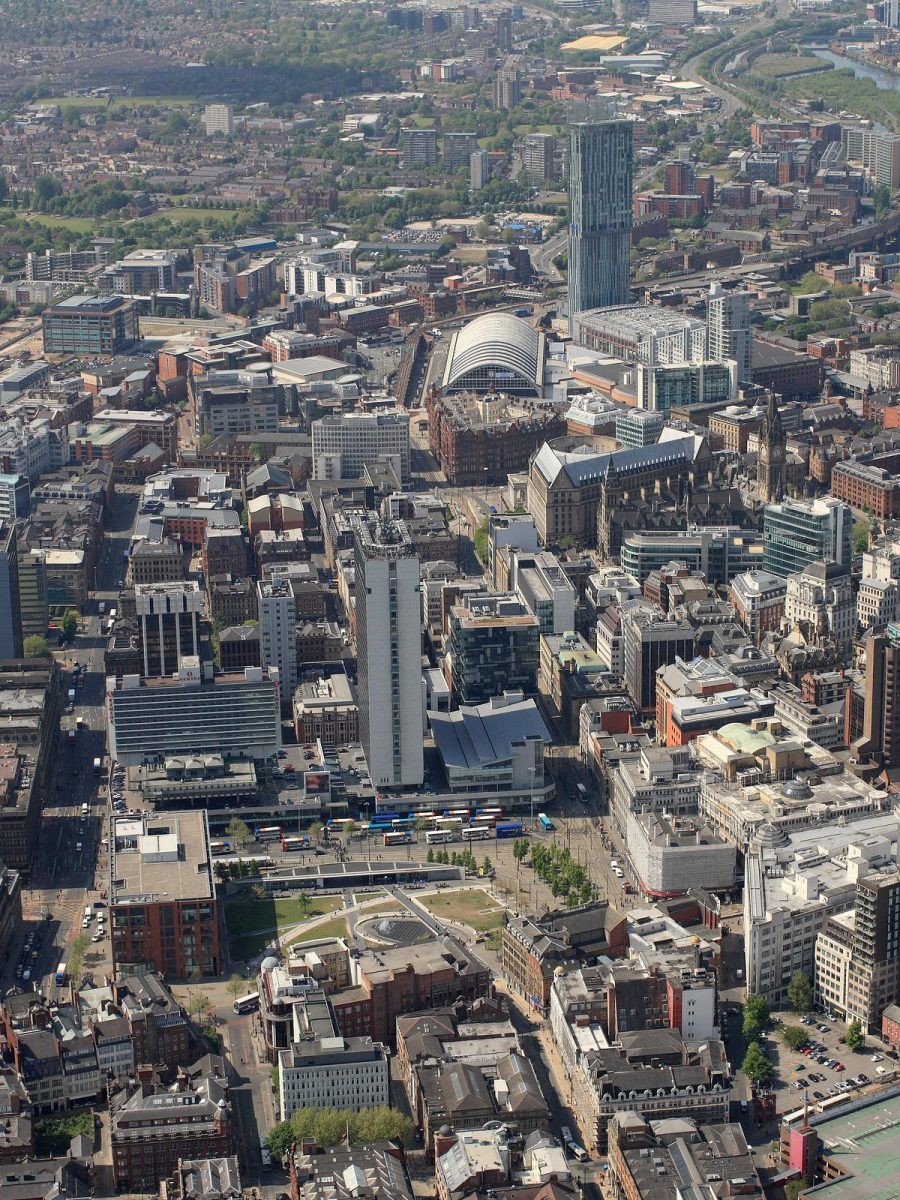 aerial view of Manchester City centre showing Piccadilly Gardens in the foreground. Also in the photo are Mosley Street, Piccadilly, Manchester M2 3AN, Piccadilly  M1 1LQ,Portland Street  M1 3LA  and  New York St Manchester, Greater Manchester M1 4JB