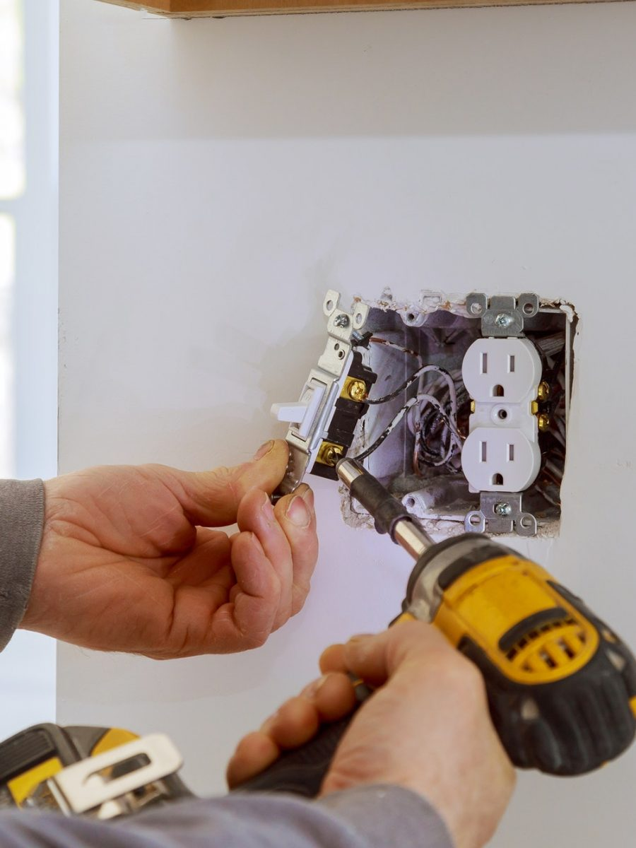 work-on-installing-electrical-outlets-with-electrical-wires-and-connector-installed-in-plasterboard